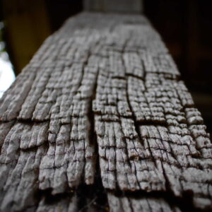 A close up of an ancient wooden support beam