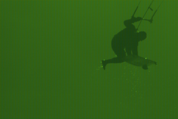 Green highly patterened close up of surfer